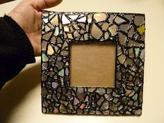 Mosaic frame from old cd's.  Ashley would love this idea!