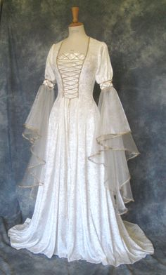 Amelia, a Fairytale, Elven, Medieval, Renaissance Wedding or Hand Fasting Dress in Ivory.. $302.00, via Etsy. elven wedding dresses Steampunk Fashion Check out my sites:) http://www.designyourownperfume.co.uk http://www.myoldfashionedrecipes.com