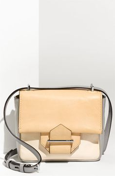 Reed Krakoff mini structured architectural bag grounds bold colors with its soothing neutrals and beautiful tailoring.
