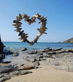 Driftwood Heart on the Beach. it would be nice to erase the string to make it look as if it were a giant heart shape suspended off the beach floor. Driftwood Projects, Driftwood Art, Driftwood Mobile, Driftwood Ideas, Heart In Nature, Heart Art, Valentine Love, Valentines, I Love Heart