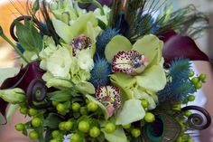 Peacock feather inspired wedding bouquet. Marsala, Blue, Green Peacock. bouquetsbybriana.com