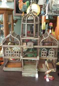 Ornate wood and metal birdhouse. My mom has this birdhouse. Going to paint it white and good.