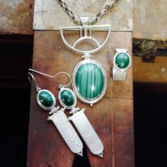 Malachite and silver jewellery, cuttlefish casting and fabrication. Made by Gecko Skin Jewellery.