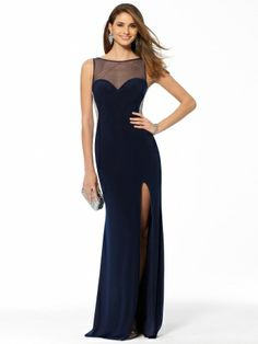 Elegant navy gown features sheer illusion front and back yoke. Sweetheart bodice with pearl trim. High slit leg. Long, flowing skirt.Sleeveless IllusionFront and BackPearl trim detailsPadded CupsHigh slit leg 100% PolyesterLining: 100% PolyesterImportSpot Clean Only