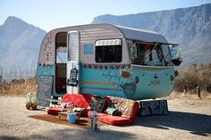 This mobile tea shop is bohemian beyond belief... but so cute. Also I like the mountain it parked in front of. Wouldn't it be fun to somehow duplicate it for a tea party? The van and spread, not the mountain.