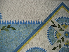 lots of feathers - also love the NYB block mixed with the applique