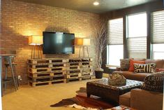 Industrial Style Living Room -- Look at the pallets again. Fabulous way to re-use an easily discarded (and overlooked item).