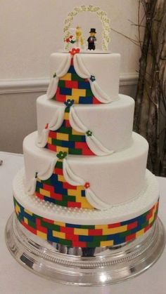 3 tier Lego wedding cake – the groom is a massive Lego enthusiast so the couple wanted a Lego themed cake! The base was custom made by sticking 5 boards together and covering in lego bricks! Lego Wedding Cakes, Unique Wedding Cakes, Beautiful Wedding Cakes, Wedding Cake Designs, Wedding Cake Toppers, Cake Wedding, Wedding Ceremony, Wedding Venues, Dream Wedding
