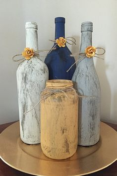 This four piece set includes a large wine bottle, two regular size wine bottles, and a mason jar. It can be made in any color to fit any color