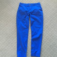 """GAP Broken-in Straight Khaki Blue 6 Fits Loose Up for purchase is a pair of GAP broken-in straight khakis. They are a size 6 in a bright blue. These have a nice, loose casual fit. Laying flat, the waist measures 16"""" (32), and the inseam measures 29"""". I wore these maybe 5 times tops. As with all my clothes, this will arrive to you freshly laundered. GAP Pants Straight Leg"""