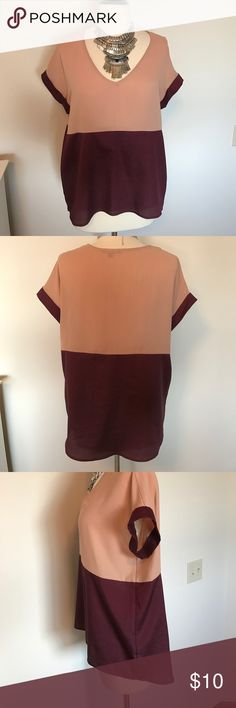 "Color block blouse Very pretty peach and purple-wine color block blouse. Slightly longer in back. Short sleeve. Front measures 24.5"", back measures 26.5"" from shoulder to hem. Necklace not included Soprano Tops Blouses"