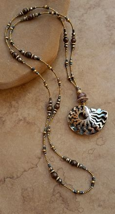 Brilliant polished pyrite fossil ammonite pendant brass and gemstone bead necklace by dawn wilson enoch deserttalismans on etsy beadedpendantnecklace collarnecklace Wire Jewelry, Boho Jewelry, Jewelry Art, Beaded Jewelry, Jewelry Design, Beaded Bracelets, Fashion Jewelry, Jewellery, Beaded Necklace Patterns