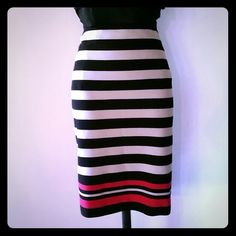 Elle Pencil Skirt A pencil skirt that has a hidden side zipper and is a black and taupe stripe  with red accent at the bottom. The fabric is a soft knit. 70% polyester, 28% Rayon & 2% spandex.   Fits me just below my knee.  Good condition. Elle  Skirts