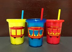 This is a set of three (3) Daniel Tiger Trolley toddler/childrens drinking cups with tops and straws. Perfect for everyday use or a unique personalized gift. This is sure to be a mealtime favorite! Fill with goodies for an adorable personalized birthday party favor that any Daniel Tiger fan will love!   Cup Specifications: - Holds 10 oz - BPA & PVC Free - Multicolored, mix and match cups, tops, and straws. Each order will contain three of the following color options: red, yellow, ora...