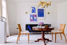 In the dining room, vintage lithos by Matisse, Yves Klein and Don Kunkel make an eye-catching group set above an Ettore Sottsass sofa. A turn of the century barley twist dining table is paired with four Jean-Michel Frank style modern chairs. The chandelier and sconces are by Sciolari, and the steel sculpture is by artist Adam Curtis.