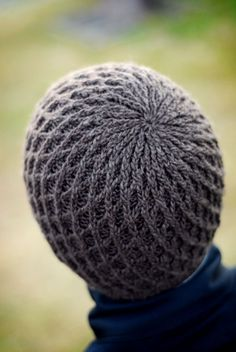 This pattern originally appeared in the Fall 2007 issue of Interweave Knits magazine. The design was inspired by the work of Dutch architect Rem Koolhaas. His geometric, structural patterns at the Seattle Public Library informed the cabled lattice motif encircling the beanie.