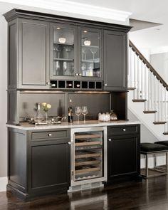 Beautiful living room bar nook features gray raised panel bar ...