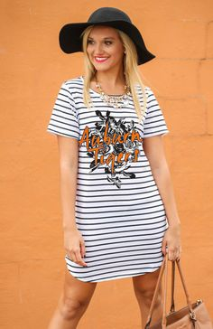 262f53d6afc66 This Game Day Couture little striped t-shirt dress features floral pattern  over black and white stripes. Embellishment features floral print and ...