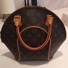 Authentic Louis Vuitton Ellipse Monogram Authentic Louis Vuitton Ellipse bag. This style is very unique as Louis Vuitton doesn't make it anymore. Measurements are about 12.2 x 9.8 x 5.5 approx. Inside has a small amount of normal wear. Bag is in excellent condition. No lock and no dustbag. (If not having these two items is an issue I may be able to find extra ones from other bags of mine) Louis Vuitton Bags Totes