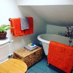 Here's a #beforeandafter for yesterday's BATHROOM DETAIL for #myhousethismonth . It's a tiny space but I was adamant we would find a bath to fit under the eaves! The LO definitely appreciates it every night! 👦🏼💦🌊 . I think that's me all caught up for now! 🤗 . . . . . #instahome #dailydecordetail #bathroomdecor #bathroomremodel #bathtime #orange #bathroom #diy #rolltopbath #interiordesign #interiorinspo #homedecor #renovation #colourful #victorianhouse #myhshome #sahstylists…
