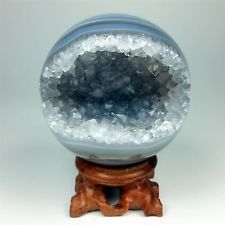 A lovely agate geode sphere full of quartz crystals