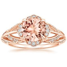 Glistening pavé diamond leaves ascend to form a floral halo that encircles the center morganite in this resplendent diamond ring. The ring's gentle curvature and open detailing allows the beautiful design to sparkle from all angles. #BrilliantEarth
