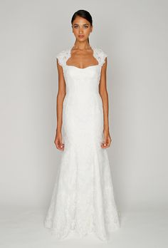 Brides: Bliss by Monique Lhuillier :  BL1210    Ivory re-embroidered lace and Chantilly lace cap sleeve modified trumpet gown with signature low back and full skirt.