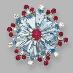 Platinum, Aquamarine, Ruby and Diamond Brooch, Oscar Heyman & Brothers, 1953 Designed as a snowflake set with calf's-head-cut aquamarines, cabochon rubies, and round and baguette diamonds weighing approximately 1.50 carats, unsigned, numbered 46850.