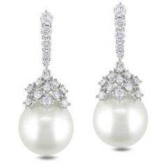 These  are 10-12 mm round white South Sea pearls and 1 carat of white diamonds set in 14-karat white gold. The beautiful earrings are secured with butterfly backs. (price: 1822.00)