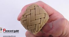 One two three Grafton variation of the gaucho knot tightened on a wooden sphere.