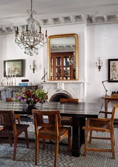 Old wooden chairs and ornate vintage details in the dining room.