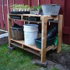 Recycled pallets make up both the top and bottom shelf of this garden bench. Four 2x4s cut to the same length are screwed into the sides for legs. The interiors of the pallets make handy shelves, keeping small tools and supplies sheltered and stored away.