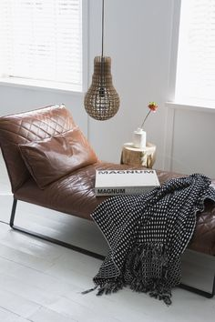 Brown leather daybed and white walls