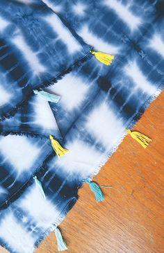 Learn how to dye a plain scarf Shibori style, then add tassels