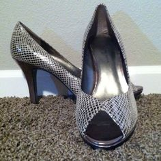 AK Anne Klein snake pumps Oh so comfortable size 8 1/2 Anne Klein silver faux snake peep toe pumps. Heel is four inches. Couple scuffs on heel pics are showing them and under side of toe. Can't see it from above but I thought I should note it. Anne Klein Shoes Heels