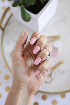 Falling head over heels for this pink, gold studded manicure.