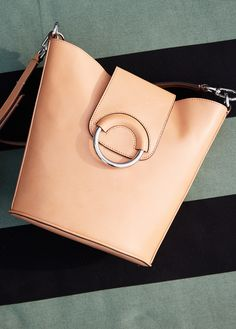 Each piece designed in fine Vachetta leather bears its own natural, individual markings and texture that become richer and more unique over time. This tan leather bucket bag is a stylish and practical everyday bag for spring   Banana Republic