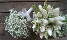 Bridal bouquet of Lily of the Valley and tulips with gypsophila 'cloud' for the bridesmaid