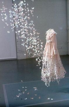 Paper dress-  wouldn't it be cool to make a paper garment and have it fluttering off into whimsical creatures?!? I'm all for it.