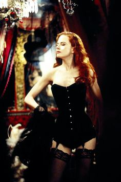Nicole Kidman poses in a black corset costume as Satine in Moulin Rouge Nicole Kidman Moulin Rouge, Satine Moulin Rouge, Moulin Rouge Movie, Moulin Rouge Costumes, Moulin Rouge Outfits, Actrices Sexy, Hot Lingerie, Black Lingerie, Movie Costumes
