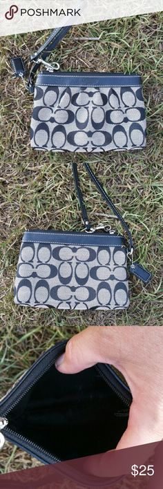 Coach signature stripe wristlet black and grey Coach signature stripe wristlet black and grey  this is an excellent gently used condition I see no marks stains or signs of wear. Bags Clutches & Wristlets