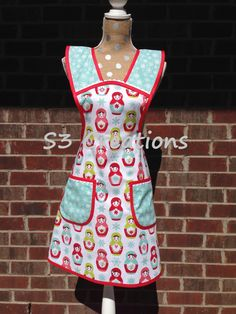 A personal favorite from my Etsy shop https://www.etsy.com/listing/251887144/matryoshka-doll-apron-with-ric-rac-trim
