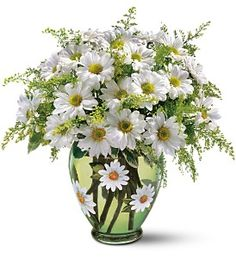 Everything's coming up daisies - the flower of spring! This exuberant arrangement features a big bunch of white daisies, nestled in a matching green glass vase that's decorated with hand-painted daisies. www.lockersflowers.com