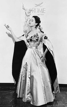 """The Fontana sisters designed this dress for Ava Gardner to wear in 1954 film """"The Barefoot Contessa."""" Gardner's patronage on and off screen helped them gain notoriety and achieve the success they did, particularly in America. The 1950s saw great success for the house. They designed for many American actresses and luminaries,  Italian dignitaries and aristocrats. Known for wasp-waisted, full-skirted evening dresses, high-quality beautiful materials frequently decorated w/ exquisite…"""