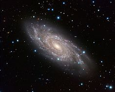 """The Blinking Galaxy: NGC 6118, a grand-design spiral galaxy, shines bright in this image, displaying its central bar and tight spiral arms from its home in the constellation of Serpens (The Snake). The galaxy is sometimes known to amateur astronomers as the """"Blinking Galaxy"""" because this relatively faint, fuzzy object would appear to flick into existence when viewed through their telescopes in a certain orientation, and then suddenly disappear again as the eye position shifted."""