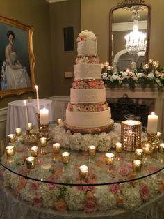 white hydrangea, blush, orange and ivory roses, gold mercury glass