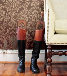Riding boots in a classy home.