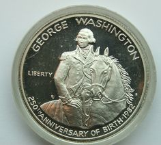 UNC 1982 US George Washington 250th Anniversary Half Dollar Silver Coin $35 This coin, the first commemorative half dollar issued since 1954.  It is also the first 90% silver coin produced by the US Mint since 1964. Designed by Elizabeth Jones, chief sculptor and engraver of the US.   GORGEOUS !!! Comes sealed in a capsule.