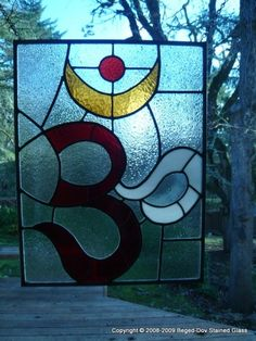 OM Symbol Stained Glass Panel by begeddovstainedglass on Etsy, $285.00