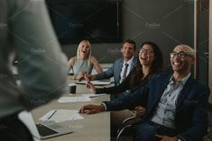 Business people laughing  by Jacob Lund Photography on @creativemarket